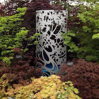 Chelsea Flower Show - Maple design. Curved laser cut screen. Norfield Nurseries display.