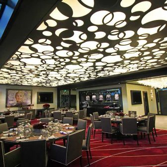 """Olympic Stadium - London. West Ham United - Director's suite. """"I'm forever blowing bubbles"""" Laser cut suspended ceiling."""