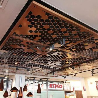 Costa Coffee - Heathrow Airport. Laser cut suspended ceiling.