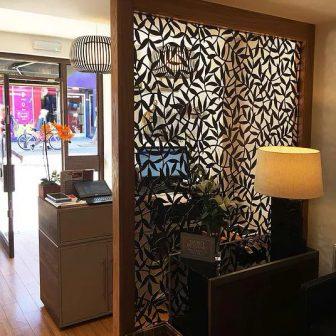Little Jasmine Salon - Brighton. Laser cut room divider. Tiger Leaf design.