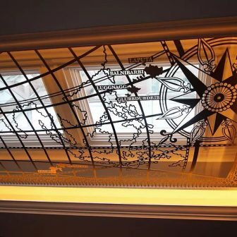 Lemuel's Bar - Conrad Hotel - Dublin. Laser cut suspended map of the world charting Gulliver's Travels.