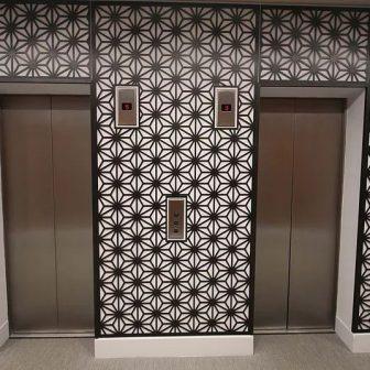 America Square - London. Foyer and elevator screens. Compass design in bronze.