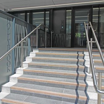 Hollybrook - Queen Elizabeth St. Laser cut screens, doors, balustrades and signage. Bamboo design with continuous flow across the building and entrance